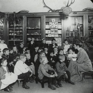 Story Hour at the Carnegie-built Webster branch of the New York Public Library, circa 1910.      New York Public Library